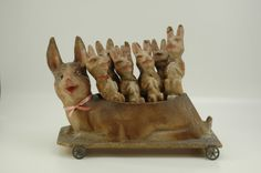 RABBIT SKITTLES SET -   Germany, c. 1870's, full set of rabbits with mother rabbit body holding all eight figures, each with applied glass eyes, pink hues at ears and mouth, wheeled base, great expressions and molding.