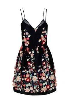 The mini embroidered lace dress by the 2nd Skin Co is cute and flirty. Its simple silhouette is accented by beautiful hand embroidered flowers that contrast its black foundation perfectly.