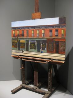 """Edward Hopper's painting easel, built by hand by the artist himself in 1924. Painting: """"Early Sunday Morning"""", 1930."""