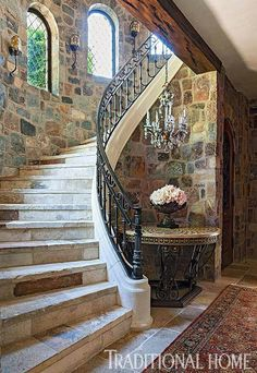 Put closet under stairs, create new wall The turret displays arched windows and a curved stone staircase that leads up to second-story bedrooms and down to a wine cellar and tasting room. Staircase Railing Design, Curved Staircase, Tuscan House, Italian Home, Italian Farmhouse, Arched Windows, Tuscan Style, California Homes, Northern California