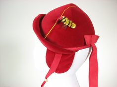 """Red vintage """"bee"""" hat. It has ear flaps so in case of cold weather you can still be fashionably dressed. And who doesn't a cute bee? So hard to resist."""