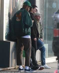 Say fromage:She later appeared to take a photo with a fan and her male friend as they leaned up against a mural
