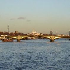 Battersea Bridge is a cast-iron and granite five-span cantilever bridge crossing the River Thames in London, England. It is situated on a sharp bend in the river, and links Battersea south of the river with Chelsea to the north. Designed by Henry Holland, it was initially opened to pedestrians in November 1771, and to vehicle traffic in 1772. In1885 it was demolished and replaced with the existing bridge, designed by Sir Joseph Bazalgette and built by John Mowlem & Co
