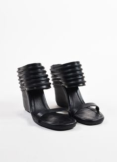 An edgy twist on the mule sandal. Supple leather construction. Thick ankle cuff with stripe cut-out detail. Thin strap across vamp. High wedge. Square open toe. Sandals slip on. Size: 37.5 Made in: It