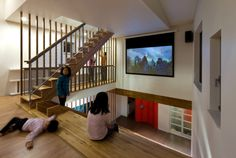 The wooden staircase integrates a slide bookshelves reading nook… Panorama House. The wooden staircase integrates a slide bookshelves reading nooks and even cinema seating. Stair Bookshelf, Bookshelves, Book Stairs, Cinema Seats, Wooden Staircases, Staircase Design, Slide Staircase, Stair Slide, Layout