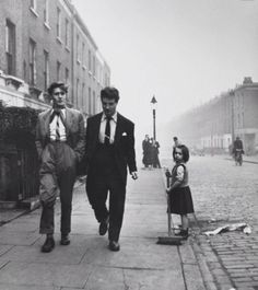 Teddy Girl wearing a pencil skirt and tight sweater. Teddy Boys on a London Street Pointed toe shoes named wink.