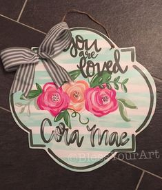 Welcome your sweet new baby girl home with this sweet floral hanger with a personalize scripture or quote. This piece is cut plywood, painted with acrylic paints, sealed with a heavy layers of clear coat and a twine hanger with pretty bow attached. Teacher Door Hangers, Hospital Door Hangers, Baby Door Hangers, Wooden Door Hangers, Canvas Door Hanger, Wooden Door Signs, Wood Signs, Wooden Doors, Wood Circles