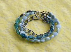 OOAK Teal Bead and Chain  Bracelet: Teal and Silver Glass Bead, Baby Blue Bead and Chain Bracelet. $19.95, via Etsy.