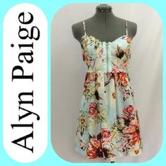 Alyn Paige Soft Foral muti-colored Sundress Alyn Paige Soft Foral muti-colored Sundress with two functioning zippers, one in the front for decoration as well as function and one in the center back. This dress has adjustable straps and bone stays in the sides of the bodice. There is elastic across the back for comfort fit. The skirt is gathered and the front has a sweetheart neckline. Size 7/8. Excellent condition. Alyn Paige Dresses