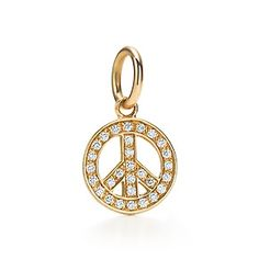 Peace Sign charm in 18k gold with diamonds.