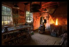 Blacksmith workshop...looks like he's modernized his shop with a constant air flow....