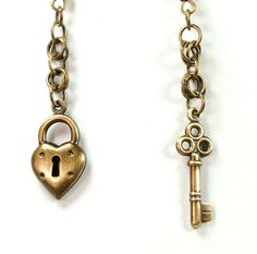 If only they were aged silver!! - Steampunk Earrings Steam Punk Earrings Charms Lock Skeleton Key Dangle Earrings Chain Maille Steampunk Jewelry By Victorian Curiosities. $9.00, via Etsy.