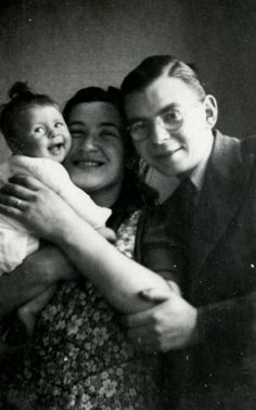 Ephraim and Johanna Rosenbaum pose with their baby daughter Betty. Her biological family died at Sobibor and her adoptive father, Jan Hageman, was executed as a member of the resistance.