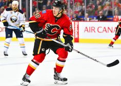 10 December 2015: Calgary Flames Center Markus Granlund (60) [8965] looks for a pass during an NHL Hockey game between the Calgary Flames and the Buffalo Sabres at the Scotiabank Saddledome in Calgary, AB. (Photo byÊJose Quiroz/Icon Sportswire)