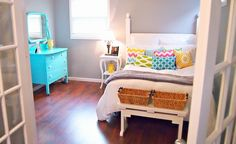 Gray walls, white bedding and colorful accents