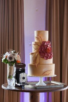 Love the flower details on this lovely #weddingcake! From http://stylemepretty.com/texas-weddings/2012/09/26/great-gatsby-inspiration-shoot-from-urban-magnolia-weddings-and-events/  Cake by http://sugarbeesweets.com/  Photo Credit: http://brittanynicolephotography.com/