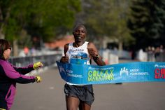Description of . Geofrey Terer wins the men's 1/2 marathon with a a time of 1:08:36 during the 9th annual Colfax Marathon May 18, 2014. The 26.2 mile Marathon runs through Denver's iconic landmark Mile High Stadium (twice), Sloan's Lake, City Park, Colfax Avenue through Lakewood and Aurora. The Marathon started and finished in City Park where runners enjoyed the rest of the day listening to music by Chris Daniels and the Kings. (Photo by John Leyba/The Denver Post)