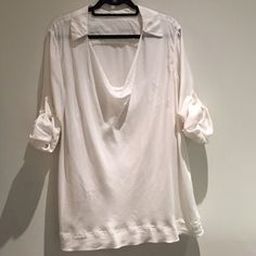DKNY off white silk blouse Tunic length, flattering fit - drapes well over curves. Drop neck. Detachable camisole included. DKNY Tops Blouses