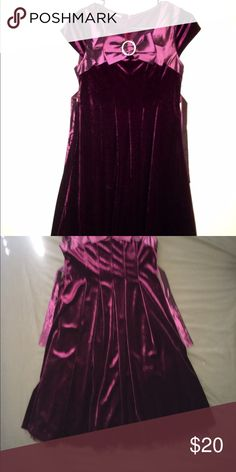 Gently Used: Velvet and Satin Girls Size 14/16 Girls size 14/16. Velvet and Satin Purple/Deep Burgandy Dress. Skirt length-Just below knee. Satin and tulle underskirt. Very dressy: for Wedding or Special Occasion. Dress size runs big. Could fit adult small. Gently used only worn once. Tag cut out. Dresses Formal