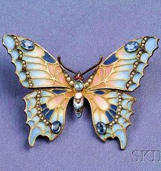 Art Nouveau Sterling Silver, Plique-a-Jour Enamel, and Gem-set Butterfly Pendant/B the plique-a-jour enamel wings with cushion-cut blue stone and seed pearl accents, cabochon red stone eyes.