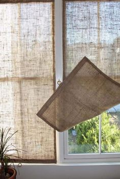 Creative Window Treatments Burlap Shades love this idea for the French doors. Summer gets real HOT where they're located.Burlap Shades love this idea for the French doors. Summer gets real HOT where they're located. Unique Window Treatments, Burlap Window Treatments, Basement Window Treatments, Window Treatments French Doors, Curtains For French Doors, Shades For French Doors, French Door Coverings, Patio Door Coverings, Farmhouse Window Treatments
