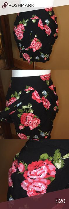 "Kimchi Blue Urban Outfitter Rose Print Tulip Skirt Kimchi blue tulip style skirt. Size 0. Excellent condition. Rayon. Black background with pink and blue roses with a tulip style skirt. Very flirty and cute for the spring and summer. Hidden back zipper. Length is 15"" Urban Outfitters Skirts"