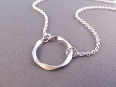 Circle Necklace -- Silver Twisted Ring Pendant -- Link. $16.00, via Etsy.