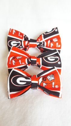 Hey, I found this really awesome Etsy listing at https://www.etsy.com/listing/215216276/dog-bowtie-made-from-uga-fabric