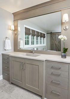 The Rift White Oak color from Grabill Cabinets makes for a light and pretty palette in this master bathroom.