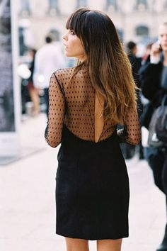 Open back, lace black dress. Latest fashion trends.