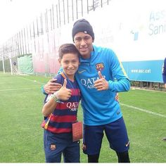 Neymar with a fan after training