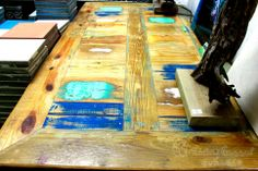 Diner table made from reclaimed wood with ocean colors. By Eugene Maduro.