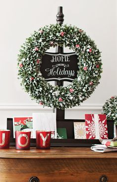 Forget the nails. Hang your Christmas wreath on a portable stand made from a table leg, a deck post cap, and a peg. Add a personalized chalkboard message to greet holiday guests.