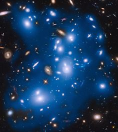 Massive galaxy cluster Abell 2744, nicknamed Pandora's Cluster, takes on a ghostly look where total starlight has been artificially colored blue in this Hubble view. - Credit: NASA/ESA/IAC/HFF Team, STScI