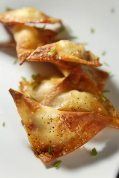 baked pepper jelly and cream cheese rangoons ... 12 wonton wrappers, 6 to 8 teaspoons cream cheese, 6 to 8 teaspoons sambal pepper jelly, 1 tablespoon olive oil, maldon sea salt (to taste), cracked black pepper (to taste), chopped chives (to garnish) .... bake at 350 for 20 minutes, flipping after 10 minutes