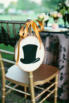 wood slab chair signs with felt decor // photo by AmandaWatsonPhoto.com // styling by EmersonEventsandDesign.com