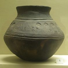 A sixth century Anglo-Saxon cremation urn decorated with crosses and runes.  Found at Loveden Hill, Lincolnshire.  The inscription seems to include a personal name 'sithaebaed'.  From the collection of the British Museum, London, England. This picture was taken with a hand held camera with no flash so the focus isn't brilliant.