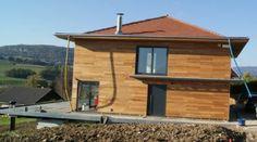 maison en ossature métallique avec habillage en bardage bois.