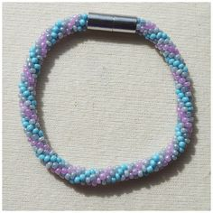 Pastel Pink, Blue and Grey Striped Bead crochet rope bracelet via CherryLime Accessories. Click on the image to see more!