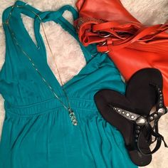 Gorgeous Teal Crossed Back Dress Only worn a few times. Material is very stretchy and comfortable. Has a halter, crossed back style.   ✅ Bundle and save on shipping! ✅ All reasonable offers are considered.  ✅ I always ship right away.  ❌ PayPal ❌ Trades ❌ Lowballing Blu Heaven Dresses Midi