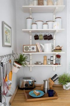 Light kitchen shelving and wooden work surface