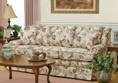 This traditional frame sports semi-attached backs with hidden zippers. Its box-t cushions are self-welted and matching throw pillows are standard. The reversible seat cushions are vented for extra comfort
