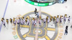 The Washington Capitals and Boston Bruins shake hands after a thrilling Game 7 of the Eastern Conference Quarterfinals during the 2012 NHL Stanley Cup Playoffs at TD Garden on April 25, 2012 in Boston, Massachusetts. (Photo by Steve Babineau/NHLI via Getty Images)