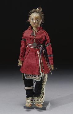 A WOODLANDS DOLL    depicting a male in a standing posture, wearing a traditional costume.