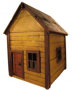 """Mustard House. Ohio, c.1900. Wood and glass. Standing 20 1/2"""" tall overall, the house measures approximately 13 1/2"""" by 15"""" around the sides. There is a hinged opening on the roof as well as a functional front door. Each side of the structure and the back have a single glazed window. The door is made complete with a knob taken from a piece of 19th century hardware. It is offered in excellent original condition and in its first and only mustard paint with brown trim. $ 650.00"""