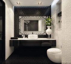 Detale, które dodadzą uroku łazience.  Efektowne lustro w dekoracyjnej ramie.