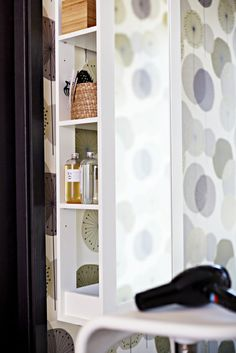 Create a stand-up vanity in your bedroom with the BRIMNES storage mirror.