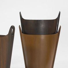 P.S. Heggen wastepaper baskets, set of seven Norway, c. 1965 teak, rosewood 15.5 w x 8.5 d x 17.5 h inches Signed with stamped manufacturer's mark to interior of each example: [P.S. Heggen Nordfjordeid Made in Norway].