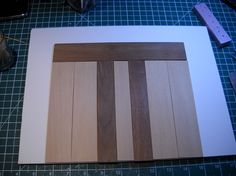 """The wood is cut for the doors. The dark ones are 1/8"""" walnut and the elevator doors are 1/16"""" bass.  Painting is next."""