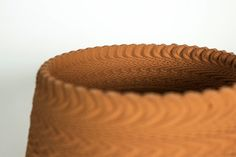 Studio van Broekhoven's ceramics look like woven baskets, but really they're 3D printed, sound-altered clay.
